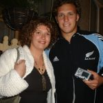 Ciara Mackey with one of the New Zealand All Blacks on their trip to Donegal