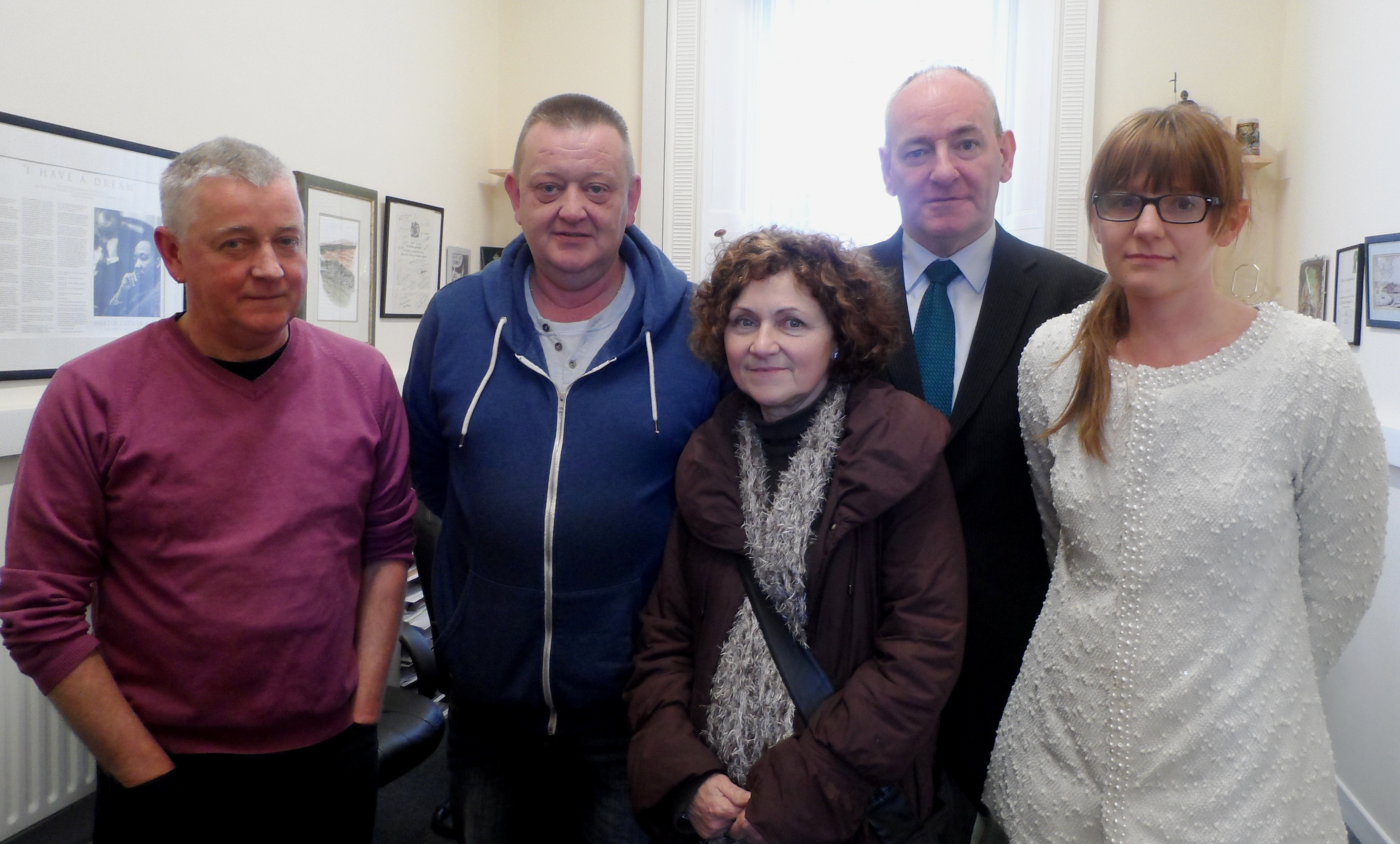 Foyle MP Mark Durkan with members of the Mc Greanery family.