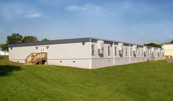 Modular Classroom Building Ipfw : Into welcomes capital programme but says more must be done