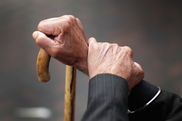 WALSALL, ENGLAND - SEPTEMBER 08:  A pensioner holds his walking stick on September 8, 2014 in Walsall, England. Britain is facing multiple problems stemming from an increase in the elderly proportion of its population, including increasing health care costs, strains on its social security system, a shortage of senior care workers and challenges to the employment market.  (Photo by Christopher Furlong/Getty Images)